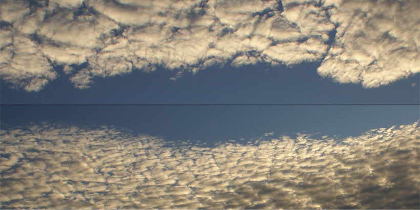 Two types of Altocumulus clouds facing each other