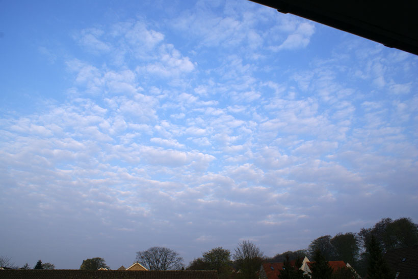 Altocumulus cloud type invading the sky